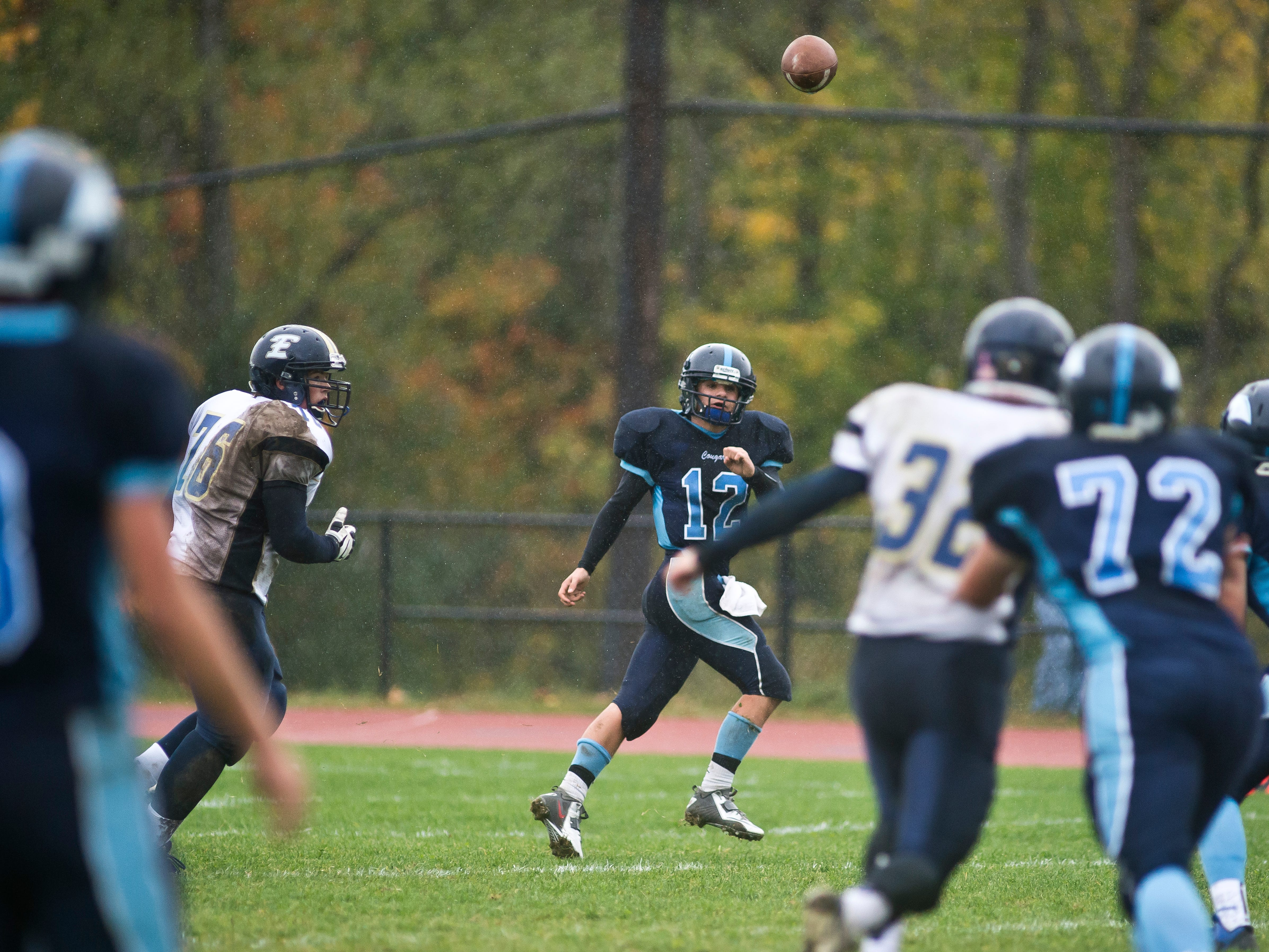 MMU's #12 Dominic Mosca lets the ball fly after being chased down by Essex defenders during their match up in Jericho Saturday.