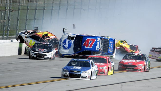 Chase Elliott (24) and AJ Allmendinger (47) take the brunt of a multi-car wreck during the closing stages of the GEICO 500 at Talladega Superspeedway.
