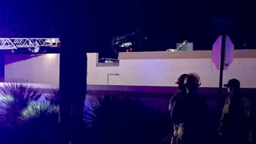 Police: 1 dead, car on top of Tucson home in fatal accident