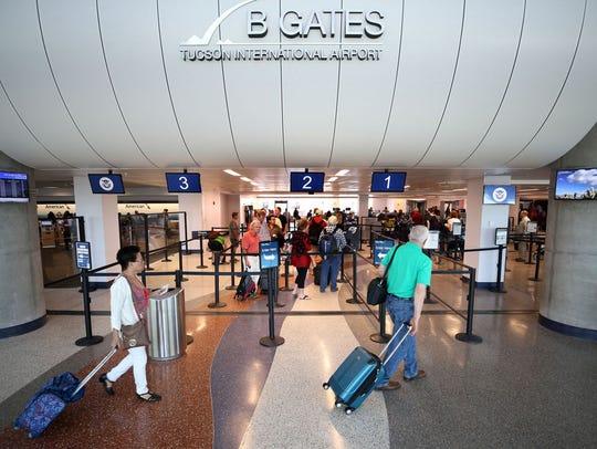 Passengers navigate Tucson International Airport in