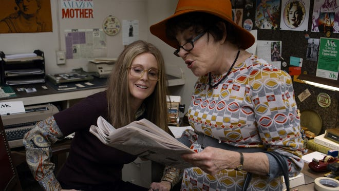 Gloria Steinem (Julianne Moore) checks out the headlines with Bella Abzug (Bette Midler).