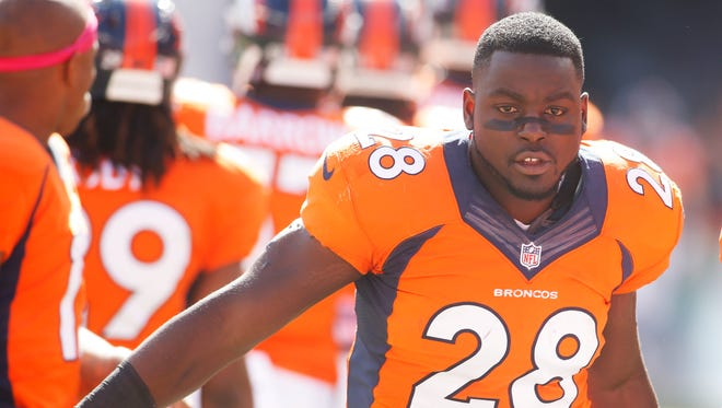 Former Denver Broncos running back Montee Ball runs onto the field before a game against the Arizona Cardinals at Sports Authority Field at Mile High. Dane Count, Wisconsin, prosecutors charged Ball on Thursday with strangulation, batter and disorderly conduct.