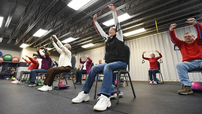 Karen Bowman of Fresno does an exercise during Silver Sneakers at Kids America recently.