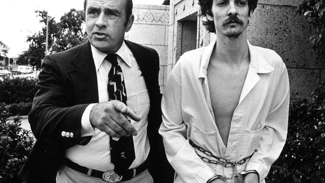 Sheriff Raymond Frank escorts David Lee Powell from the Travis County Courthouse in 1978. Powell was executed in 2010 for the killing of Austin police officer Ralph Ablanedo 32 years earlier. Frank, who died Oct. 10 at the age of 95, was buried Friday at Fort Sam Houston National Cemetery in San Antonio.