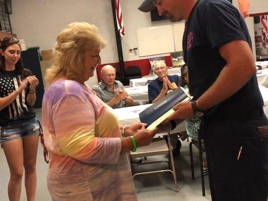 Josh Amspaugh presented Linda Peterson a Certificate