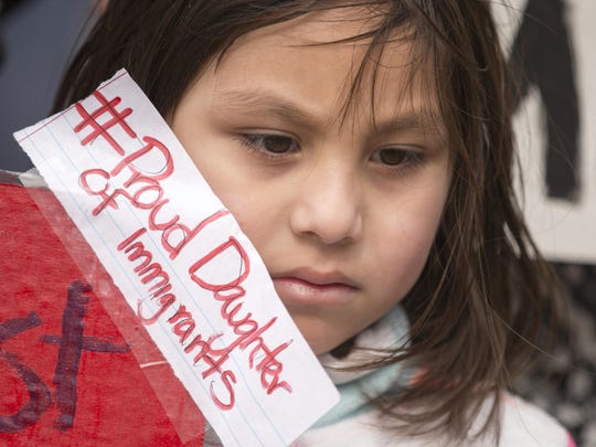 Viviana Torres, 6, Indianapolis, during the march and rally.