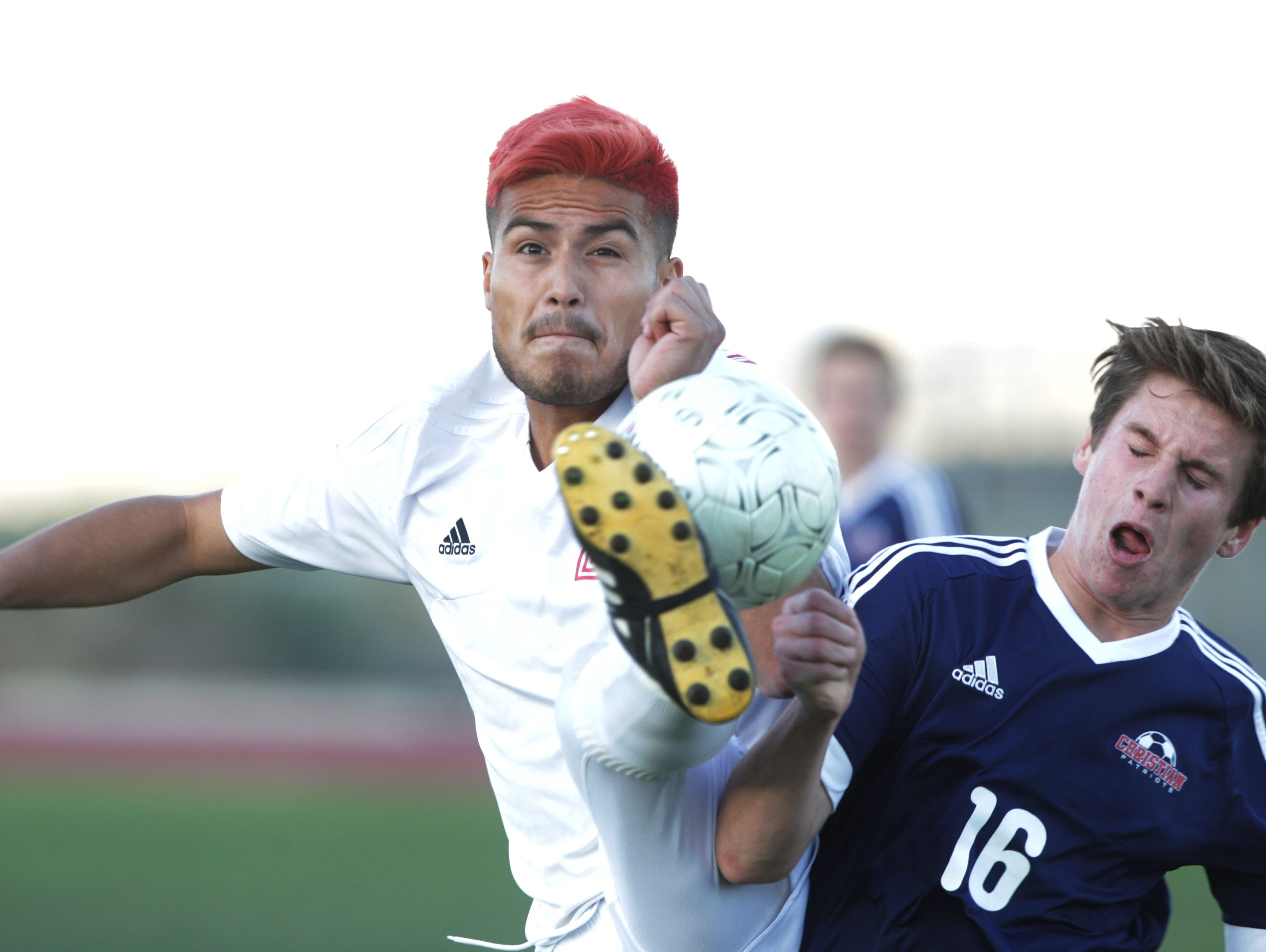 At left, Julio Rivera of Desert Mirage High School stops the ball from opponent Jake Downer of Christian High School in El Cajon at Thermal. The Rams continue to be undefeated.