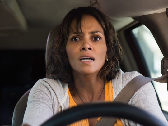 Karla (Halle Berry) keeps her eyes on the car that