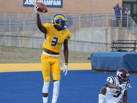 Angelo State University wide receiver Keke Chism celebrates after scoring on a 15-yard touchdown pass from quarterback Jake Faber in a 51-3 win against West Texas A&M on Senior Day at LeGrand Stadium at 1st Community Credit Union Field on Saturday, Nov. 4, 2017.