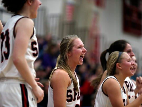 SPASH players react as a teammate scores near the end of the game during the girl's basketball regional semifinal game between Stevens Point Area Senior High and Eau Claire Memorial in Stevens Point, Wis., February 23, 2018.