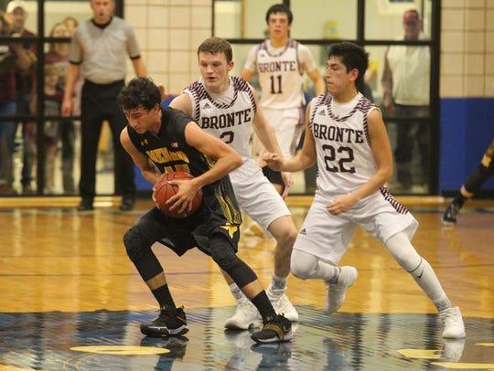 Menard High School's Brody Baugh (15) maintains control