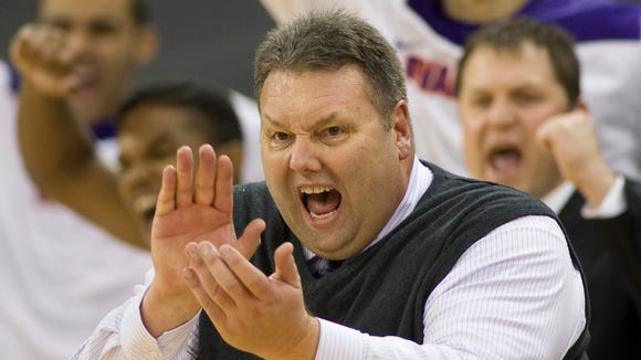 Purple Aces coach Marty Simmons and his bench erupt after another big basket during the first half of their game against the Valparaiso Crusaders at the Ford Center, Nov. 20, 2013.