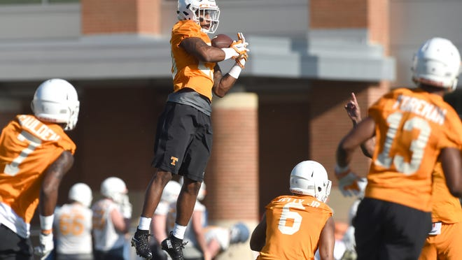Tennessee defensive back Cameron Sutton (23), center, catches a punt during spring practice at Haslam Field on Tuesday, March 8, 2016. (ADAM LAU/NEWS SENTINEL)