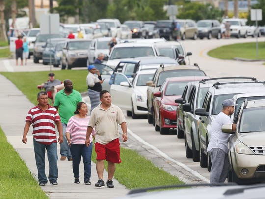 Thousands of people line up Saturday to enter a hurricane