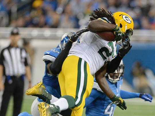 Green Bay Packers running back Eddie Lacy (27) leaps defender Darius Slay (23) during a run against the Detroit Lions at Ford Field in Detroit September 21, 2014.