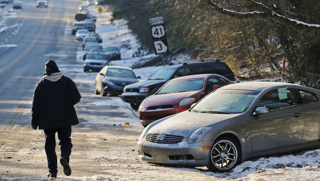 Cars abandoned during a snowstorm sit idle along Northside Parkway in Atlanta on Jan. 30.
