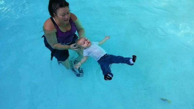 Missy Das conducts a swimming lesson with a student.