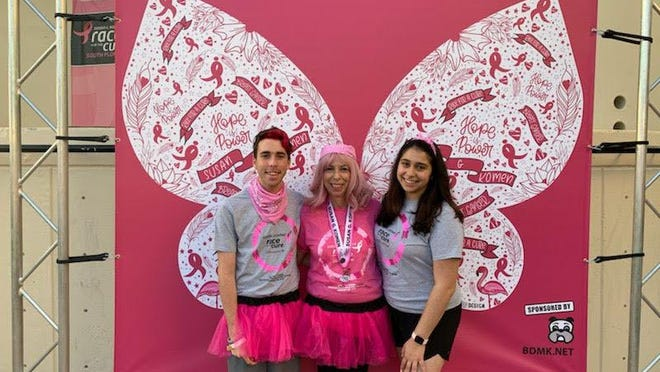 Joshua, Lisa and Talia Fitter at a cancer benefit.