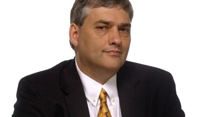 Sports Editor Cecil Hurt
