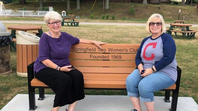 Springfield Township Woman's Club President Nancy Wright (left) and Vice President Nancy Rudy sit on the bench at Springfield Lake Park that was dedicated by the club.