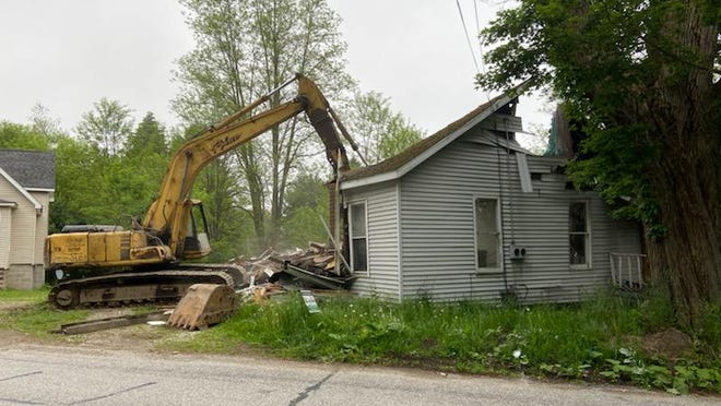 A demolition crew tears down a home at 64 Market St. in Union City in June. It was the first property demolished by the Erie County Land Bank. The owner of the home donated it to the land bank after a tree fell on it and an insurance company deemed it a total loss.