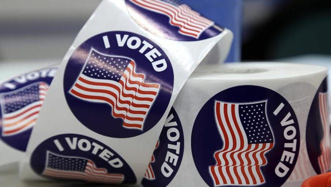 Stickers await voters after they cast their votes on Election Day on Nov. 4, 2014.