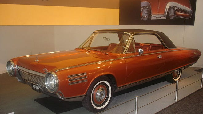 "Introduced in 1963, the Chrysler Turbine Car with its jet-like gas turbine engine arrived for a unique test drive evaluation. The rear featured the novel backup light ""afterburners."""