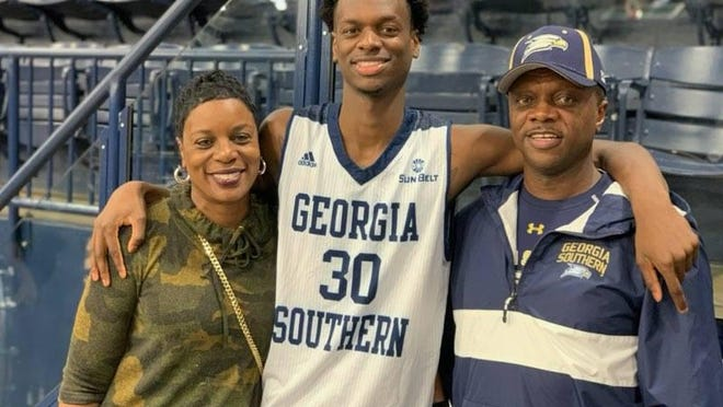 Georgia Southern forward Jordan Walker, center, and his mother, Mary, and father, Tony.