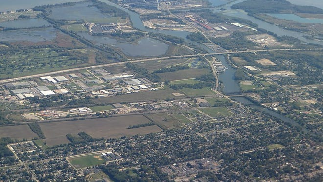 This aerial photo shows the River Raisin at Monroe, circa 2020.