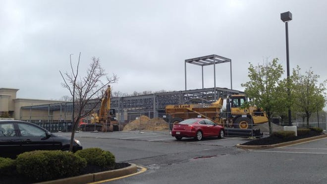 A steel frame marks the beginnings of an   expansion   of the Howell Commons   plaza.