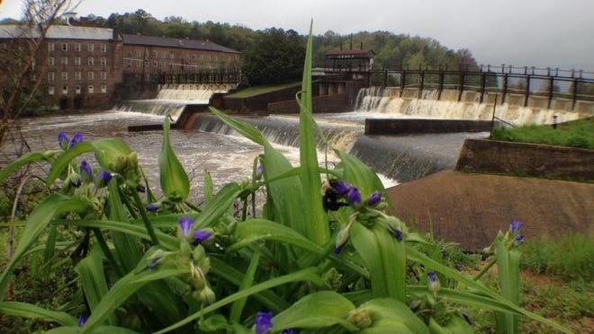 The mill pond dam in downtown Prattville shows affects of high water Monday morning.