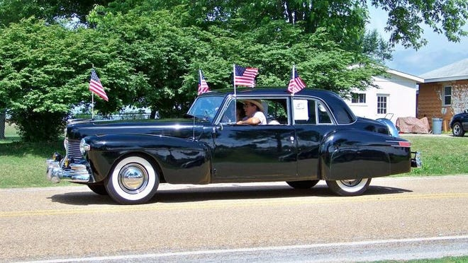 Classic cars such as this in last year's Gassville in the Park parade will be on display at the car show and automotive swap meet.