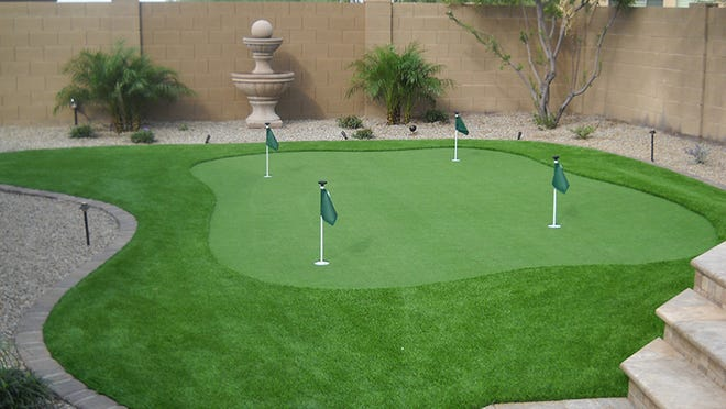 While the steaks grill, your guests can play on a miniature putting green.