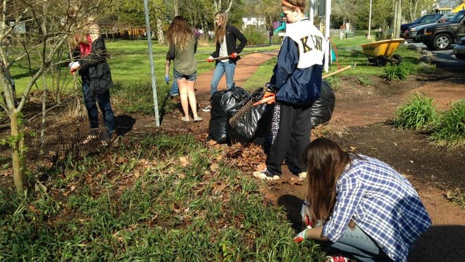 In this file photo, volunteers raked up leaves and neatened flower beds at Stephen Decatur Park for the annual Berlin Clean-Up Saturday.