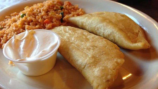 Empanadas el portal is two folded tortillas with a choice of Mexican sausage, beef, chicken, cheese and potatoes inside. Our reviewer had chicken.