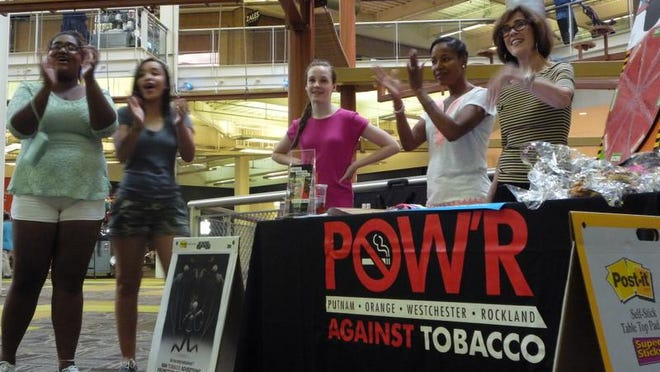In May, members of POW'R Against Tobacco visited the Palisades Center in West Nyack to celebrate World No Tobacco Day, and cheer the mall's one-year anniversary of banning smoking on its grounds. Denise Hogan, right, is coordinator of POW'R Against Tobacco in White Plains, a program of the American Lung Association of the Northeast.