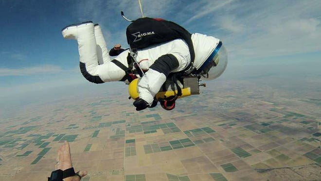 Wearing a suit developed by Delaware-based ILC Dover, Google executive Alan Eustace free-falls over New Mexico in a record-breaking skydive from the edge of space.