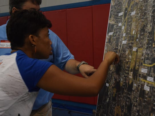 Cassandra Brown points out on a map where there are