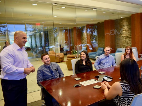 CEO Dave Zowine and several team members meet for training.