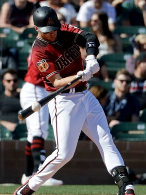 Arizona Diamondbacks' Brandon Drury bats against the Colorado Rockies during a spring baseball game in Scottsdale, Ariz., Saturday, Feb. 25, 2017.
