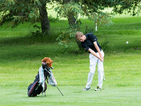 Union-Endicott's Hogan Bendert makes contact during the state golf championships at Cornell University.