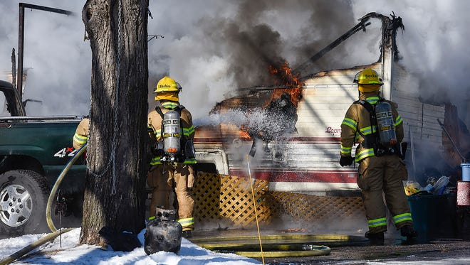 A fire that started in a camper spread to the garage, which contained two motorcycles and a sports car Tuesday, Feb. 6, at 613 Second St. N. in Waite Park.