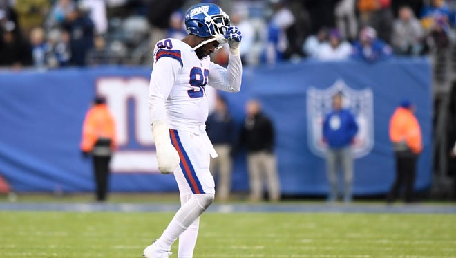New York Giants defensive end Jason Pierre-Paul (90) walks off the field after a Dallas touchdown in the second half. The Dallas Cowboys defeat the New York Giants 30-10 in East Rutherford, NJ on Sunday, December 10, 2017.