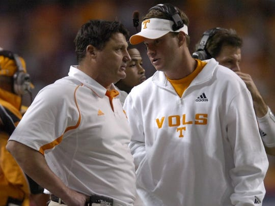 Former Vols coach Lane Kiffin talks with assistant coach Ed Orgeron during the Chick-Fil-A Bowl on Dec. 31, 2009, in Atlanta.