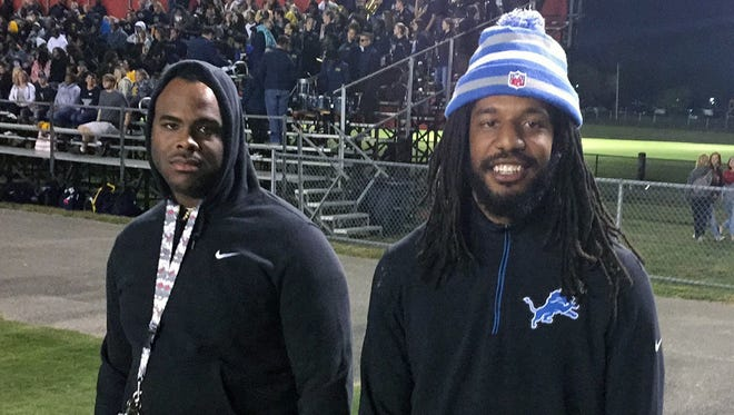 Jalen Reeves-Maybin, right) attended Friday night's Northeast game at Henry County.