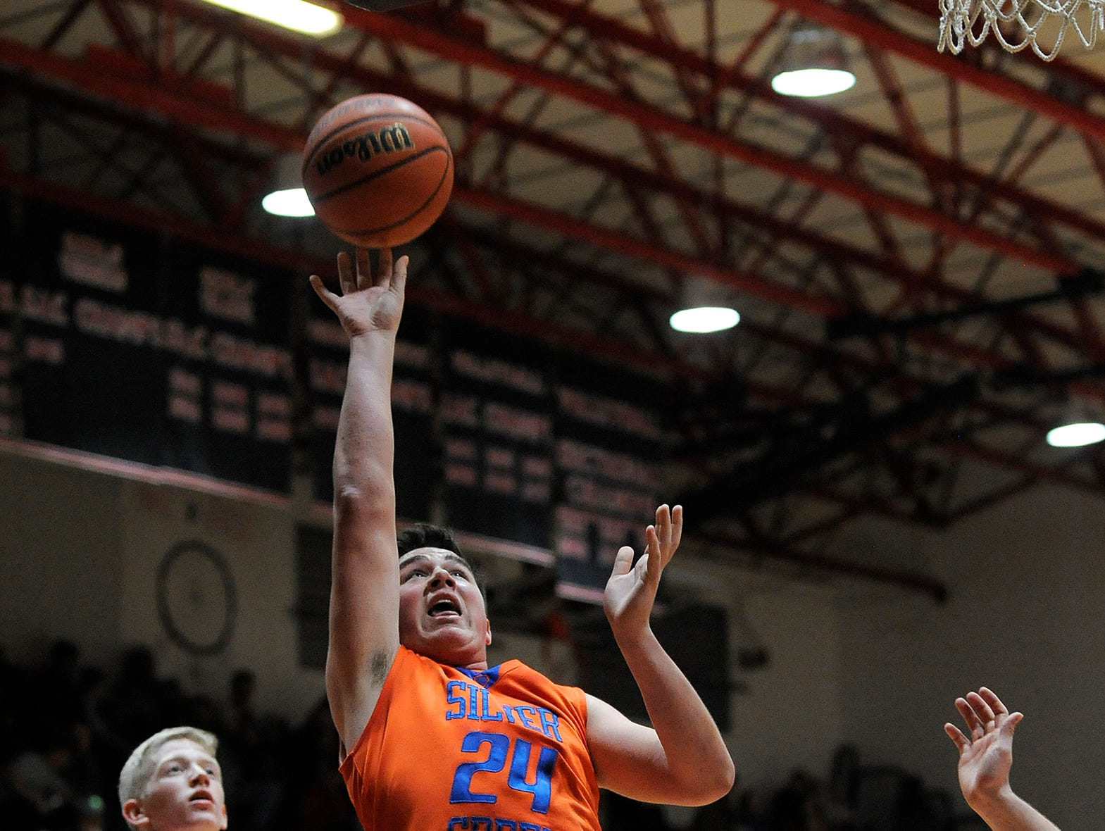 Silver Creek's Josh Landers (24) shoots against Borden's Noah Franklin (24) on Saturday at Borden High School. (Photo by David Lee Hartlage, Special to The Courier-Journal) Jan. 7, 2017