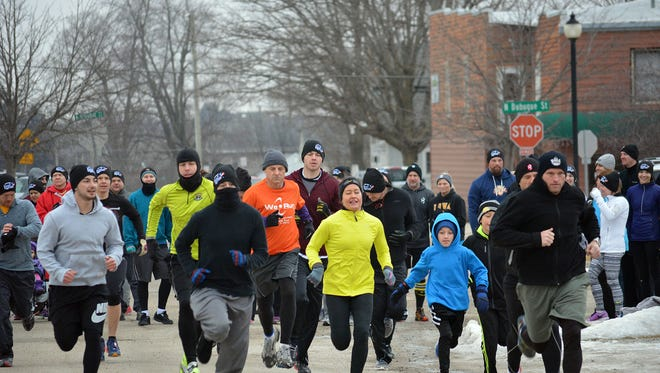 Participants take part in the inaugural Indomitable Snow Run 5K-ish Obstacle Run during North Liberty's Beat the Bitter Winter Games on Feb. 6, 2016.