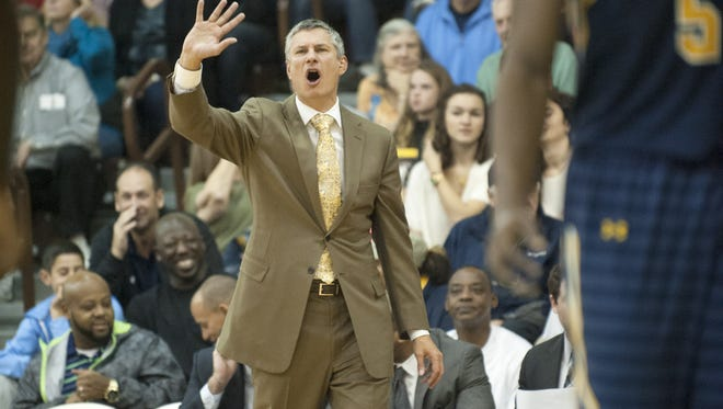 La Salle head  coach Dr. John Giannini yells instructions to his players during Saturday's men's basketball game at Rowan.