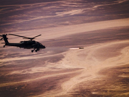 An AH-64 Apache from 1-501st fires a rocket during