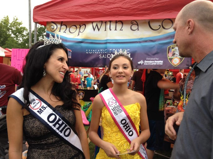 Ms. Ohio United States Heidi Sprowls, from left, and Miss Pre-Teen Ohio United States Kira West chat with Sharonville Councilman Greg Pugh during SharonFest.